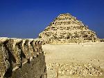 Egypte Cobra Figures and the Step Pyramid Saqqara Egypt jpg